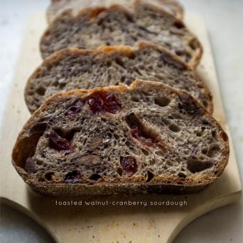 Enzo the Third Normandy Apple bread, 50% whole wheat batard, walnut-cranberry sourdough, olive sourdough bread first slice