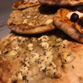 Nancy Arabic bread pizza first slice