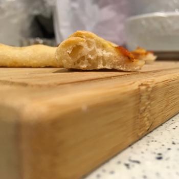 Sophia pizza second slice